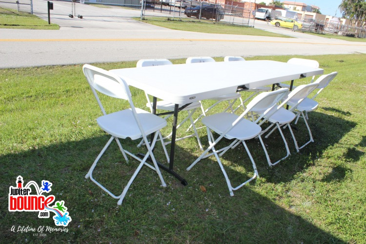Two 8' tables and 20 folding chairs